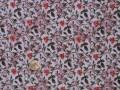 Tissu patchwork rose à fleurs orangées et feuilles vertes