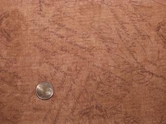 Tissu patchwork ocre à écriture